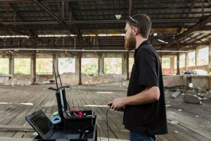 man controlling robot, video shoot