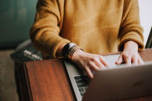 woman typing on keyboard, blog content repurposing, content creation