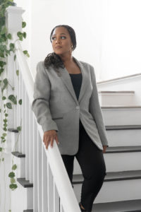 realtor branding photos, agent on a set of black and white stairs
