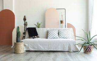 a natural canvas couch in a natural light photography studio