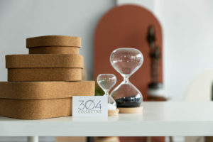 two hourglasses and natural details with a 304 Collective business card