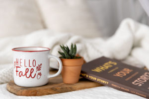 a fall themed photo set on a white bed