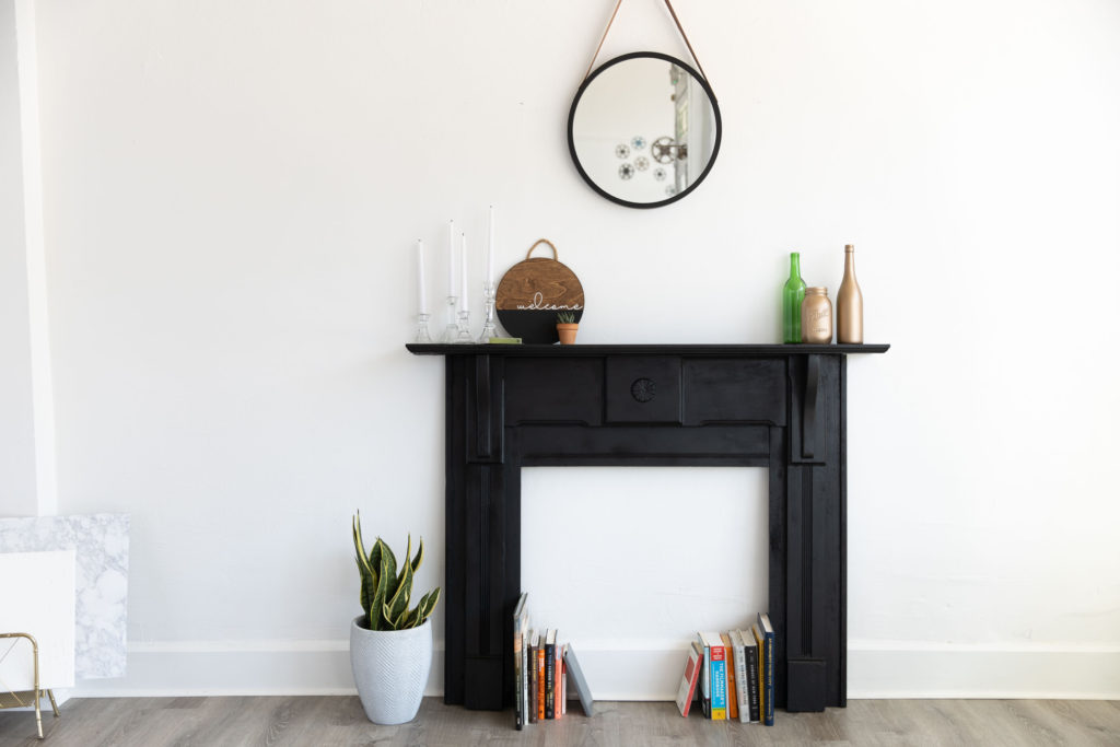 a black mantle in a natural light photography studio