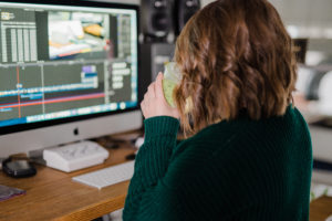 a videographer edits in her studio in fairmont wv